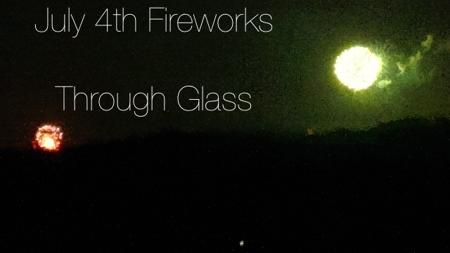 july 4th fireworks through glass